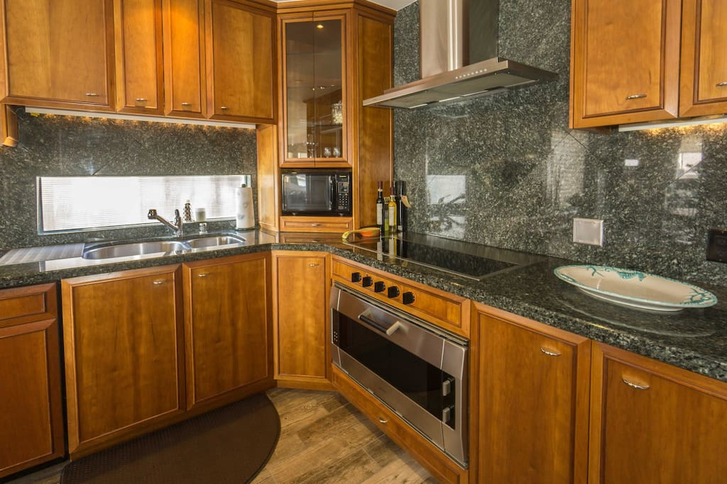 The gourmet kitchen can easily be a chefs delight!  The cabinets are filled with items to make your  food preparation even  easier!  Just a few steps away is the dining table, seating four.