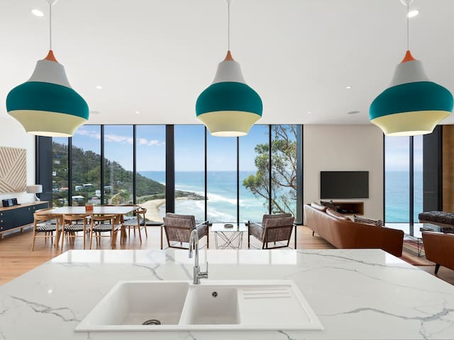 A modern and spacious open plan kitchen lounge and dining with amazing views over Wye River beach and the blue ocean.
