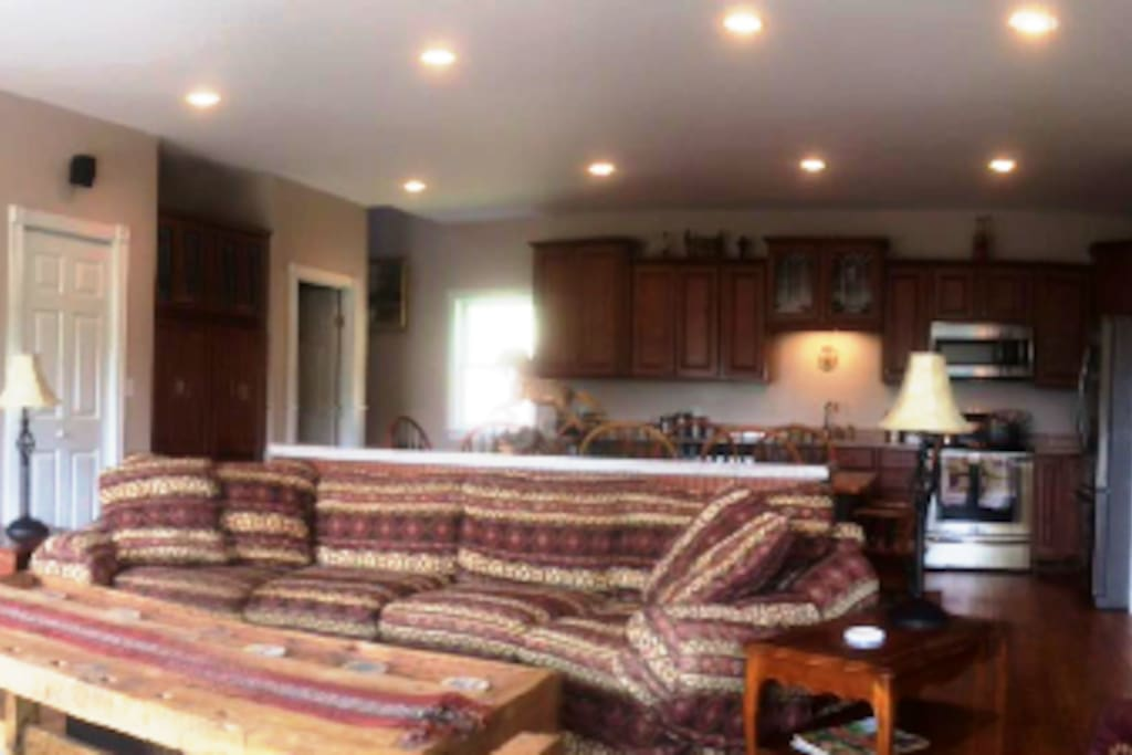 Great room with cable TV, stereo, wireless internet wood-burning stove and fully equipped kitchen.