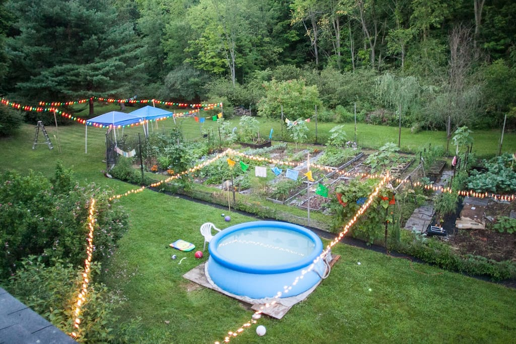In the summer, a beautiful yard with gardens, fruits/berries, hammock, and swing set for your enjoyment and use.