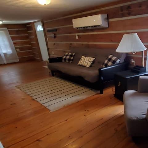 One bedroom loft log cabin apartment