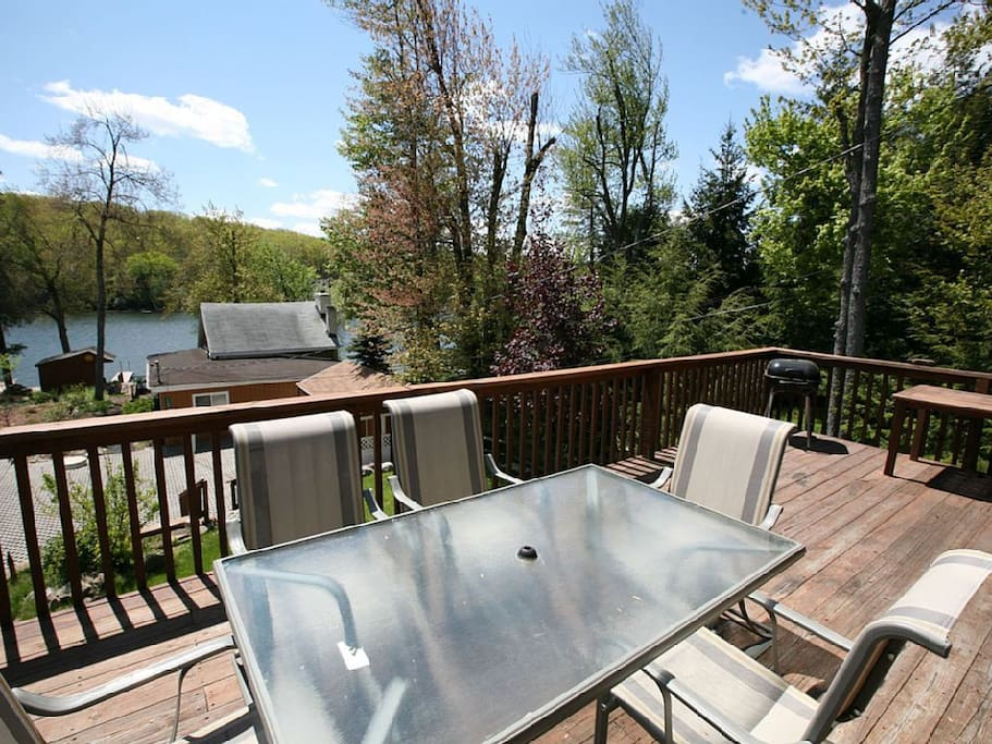 Deck area at larger house.  Now has large wood table.
