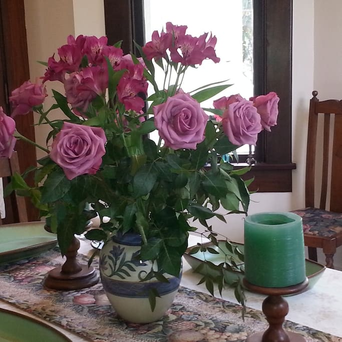 Fresh roses in dining room