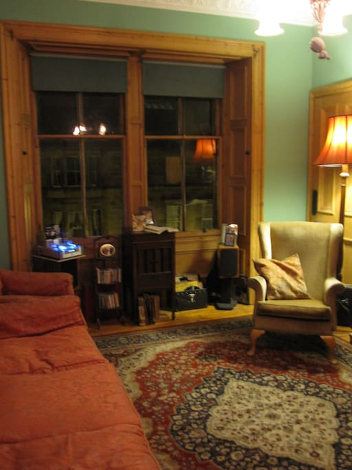 Communal sitting room retaining traditional features and period furniture