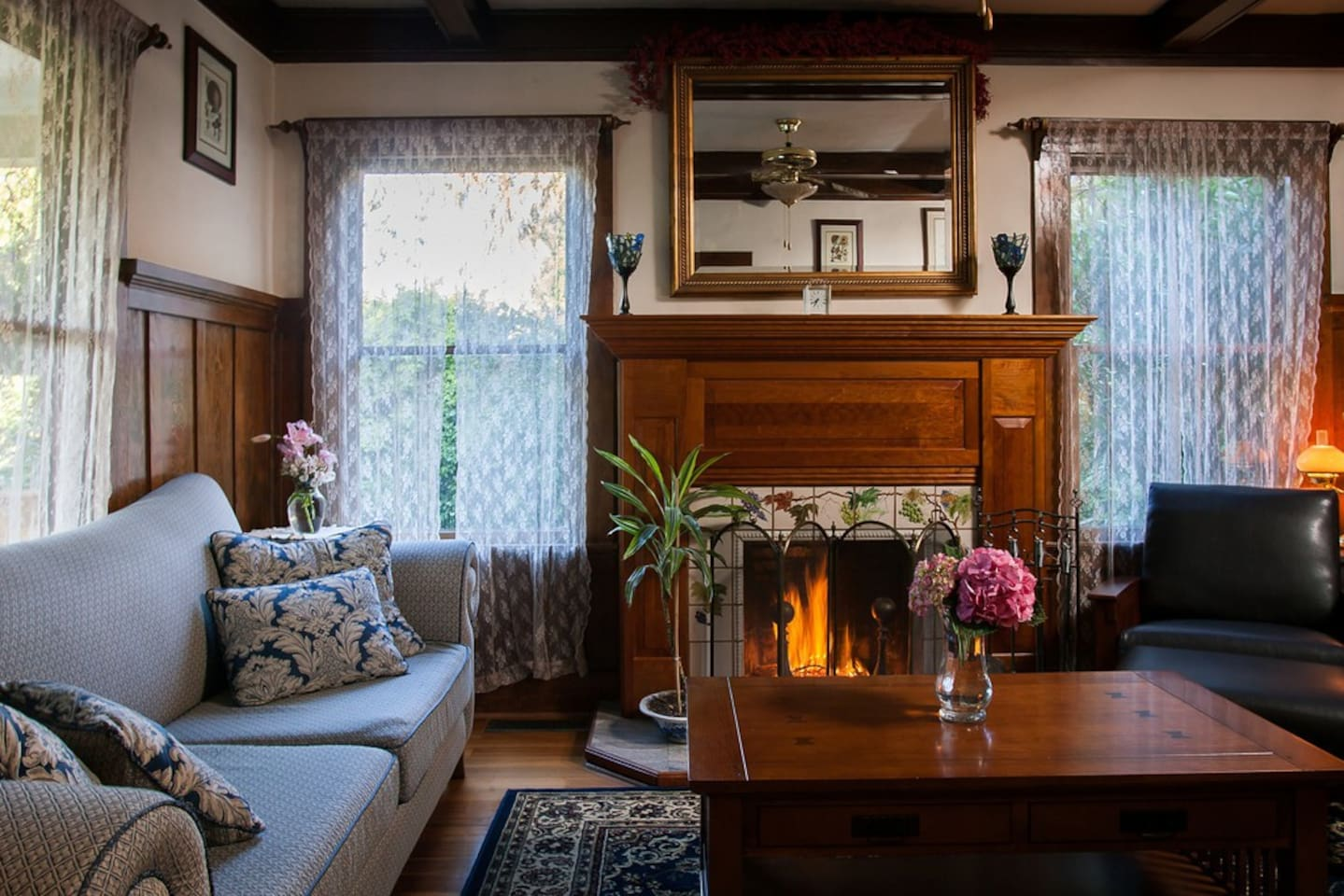 Enjoy a glass of wine by the fireplace in the parlor.