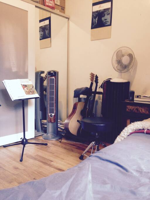 Far corner of the room - some guitars, big IKEA closet with space for you.