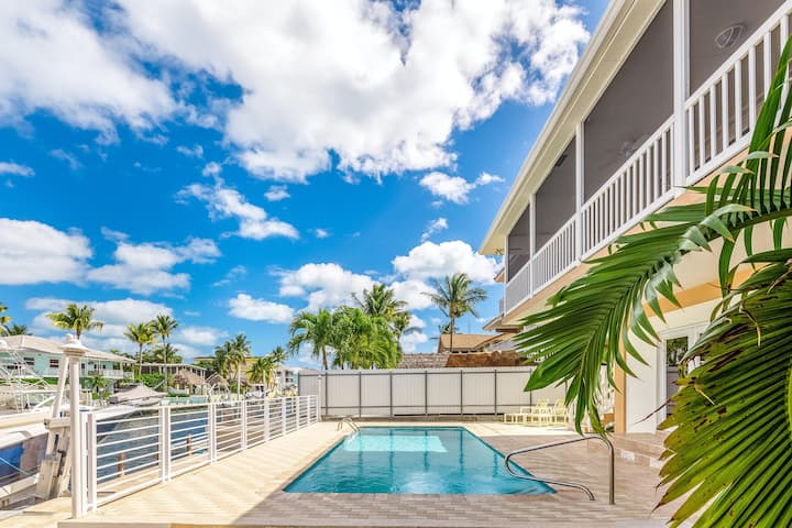 Upstairs canal-front home w/pool table/boat dock/cabana/private pool/balcony!