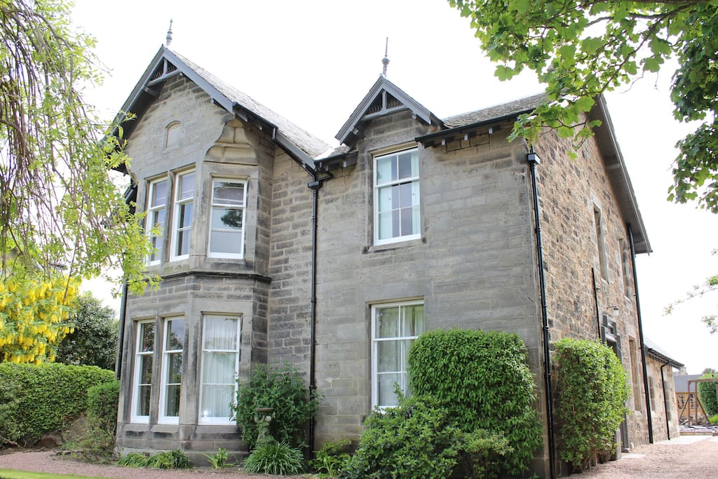 Brackness House. The room is on the ground floor to the right of the property and a guest room to the left.