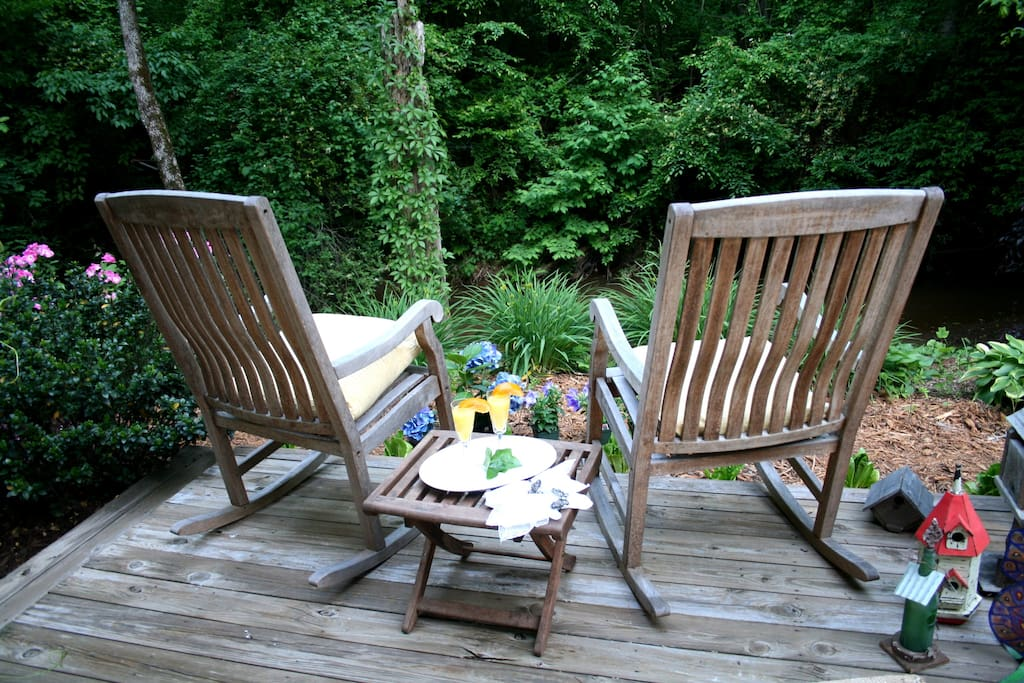 Seating by the creek: the perfect place to sip your morning coffee and enjoy the grounds