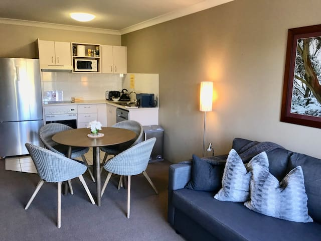 Open plan dining/lounge. 2 double sofa beds. One can be used for 2 people sleeping, one for day time sitting or two singles. Spare linen inside sofa beds