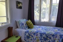 An airy sunny bedroom available with a very comfortable king single bed.