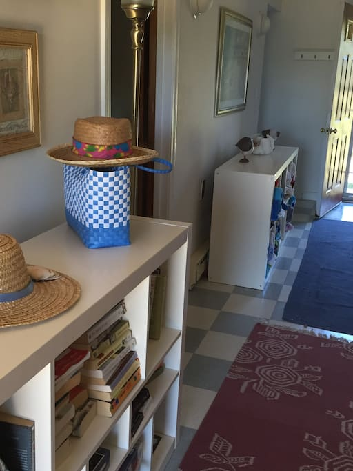 Entryway.  Plenty of books & beach towels