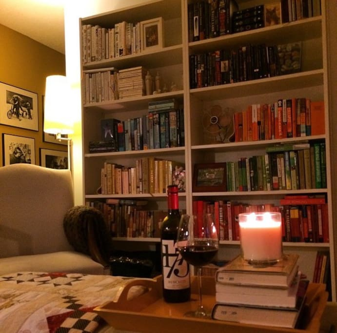 The living room is a great place to cozy up with a good book!
