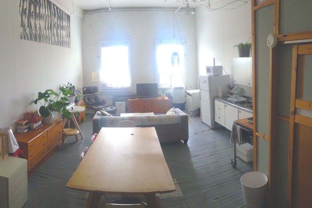 Summer 2015 updated photos. New arrangement with large dining table, updated kitchen appliances, more furniture + storage.