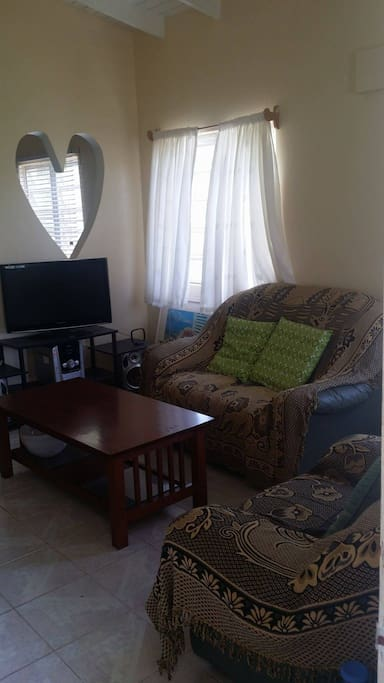 Large Living Room With Sofa and Cable TV!