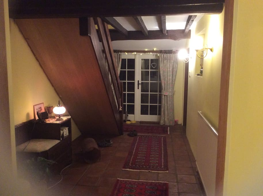 Hall way, French doors leading to private garden with seated area