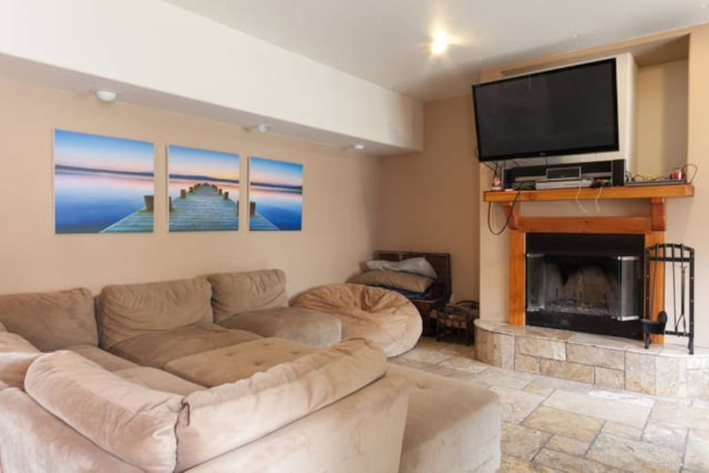 Here is another picture of the living room with Big Screen television and fire place.