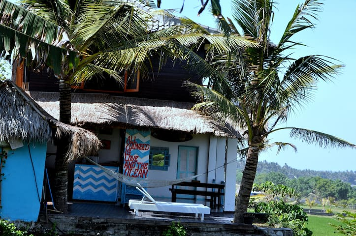 Our house in the front of ocean and surrounding by rice paddies