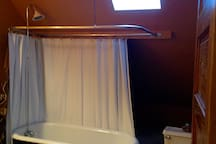 Bathroom is a mix of the old and new:  claw foot tub and skylight.