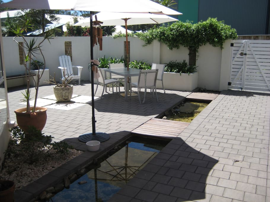 Sunfilled private courtyard for alfresco dining