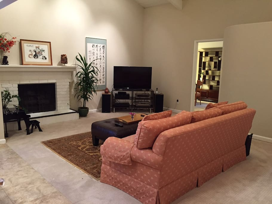 Comfortable living area with HD television and cable TV.