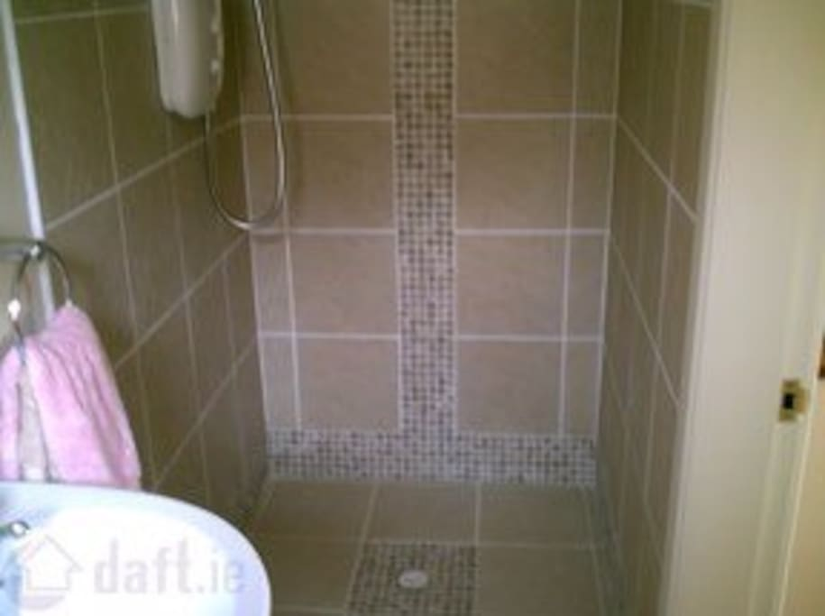 Walk in shower suitable for a wheelchair.