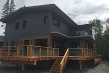 The deck wraps around for views of the backyard & Windermere Creek, Windermere Lake, and the park