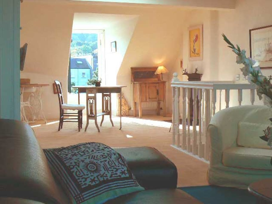 This is the other end of the sitting  room/kitchen with views extending to Carlton Hill.
