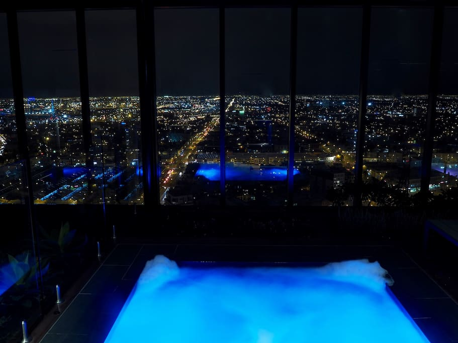2 roof top spas with panoramic views of the city on level 31