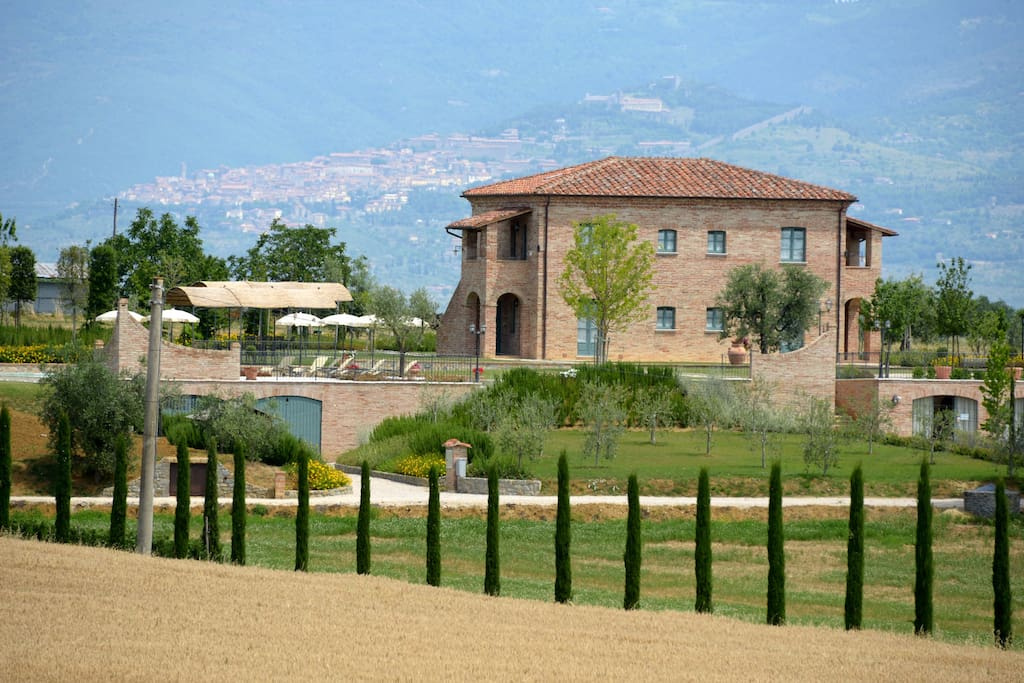 View of the farmhouse with Cortona in background.