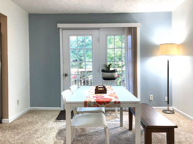 Dining area with a door opening to the second floor balcony