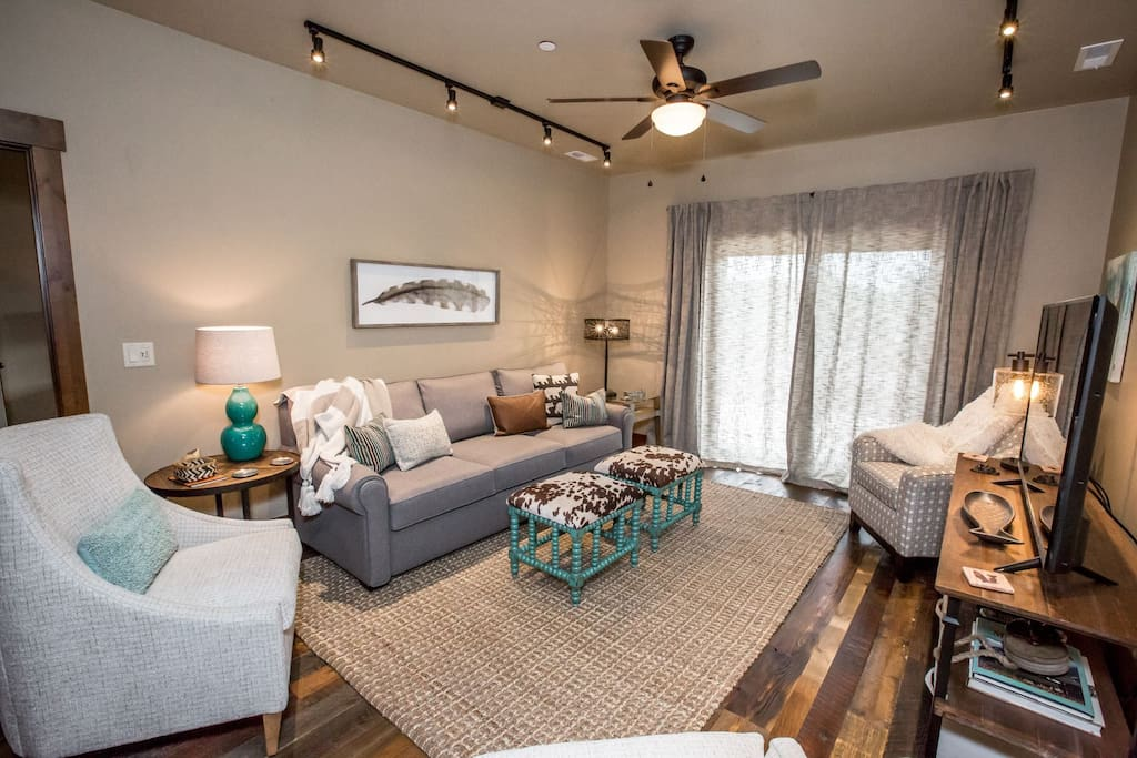 Inviting living room space with a large flatscreen TV.