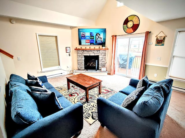 Cozy Living room w/ fireplace and walkout to front deck