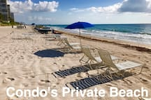 Condos private beach. Umbrellas and lounges available