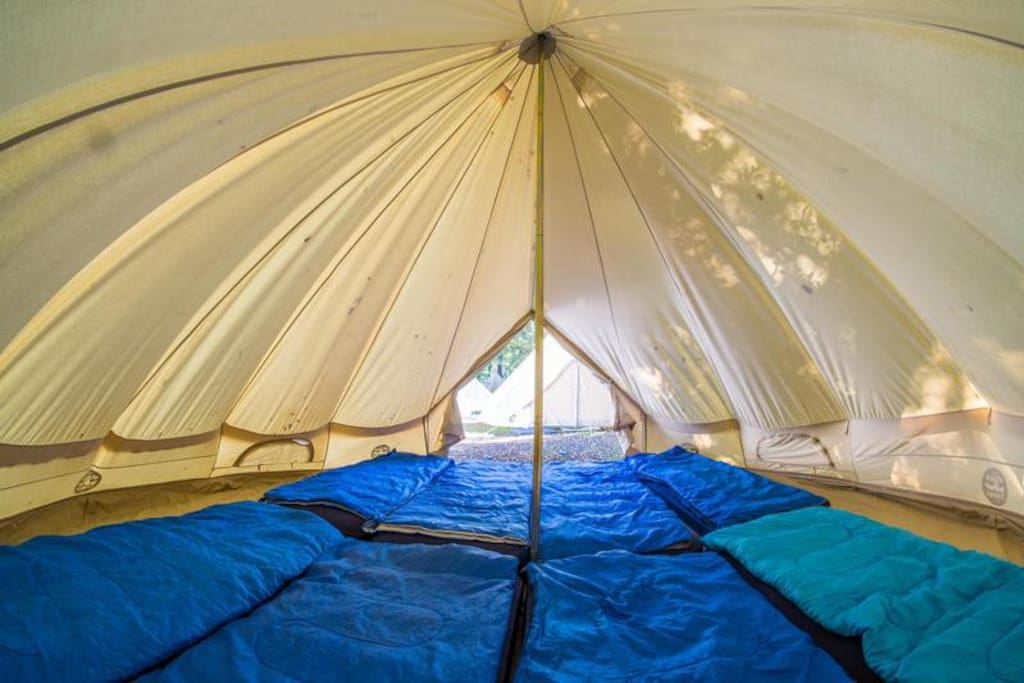 Inside the tipi. This one's set for 8, so you'll have more room than this!