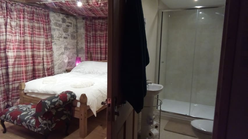 Beautiful comfortable bed with ensuite and double sided log burner