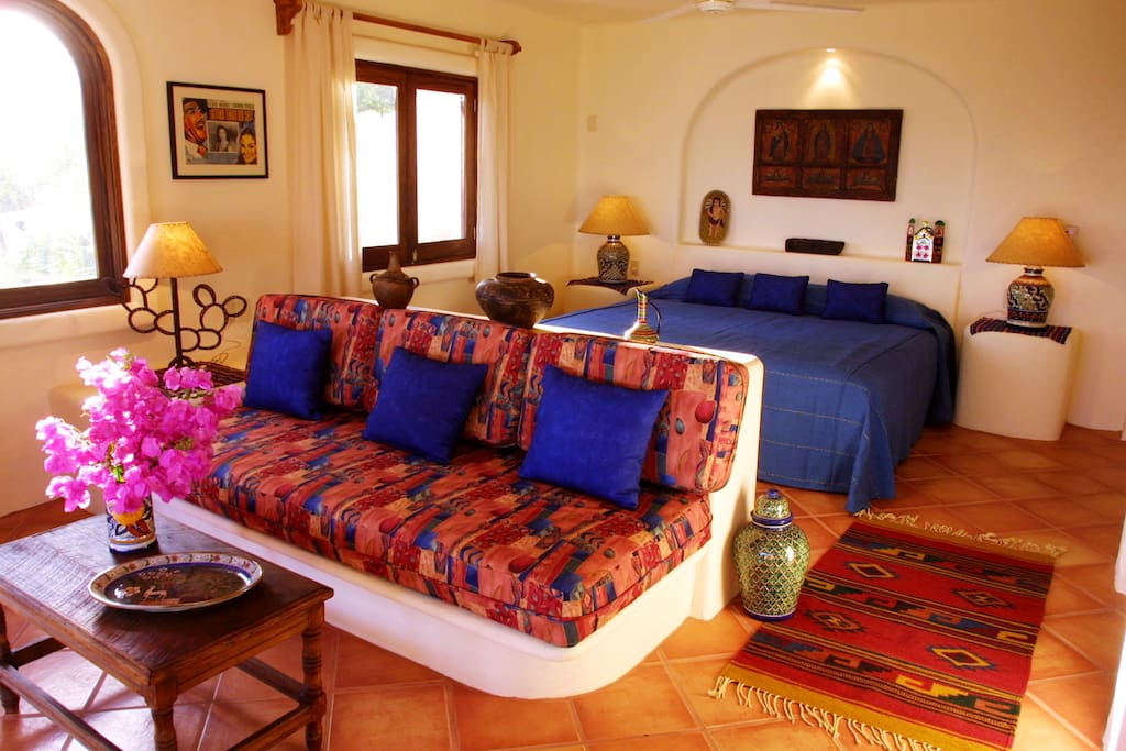 Casita bedroom with king-sized bed and livingroom