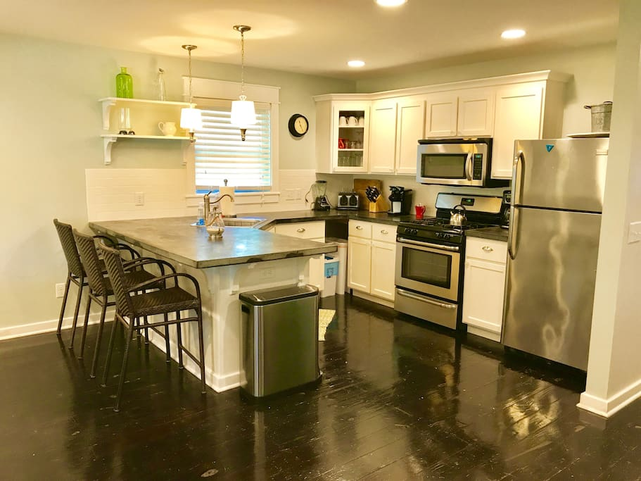 Beautiful kitchen with stainless steel appliances and concrete counters