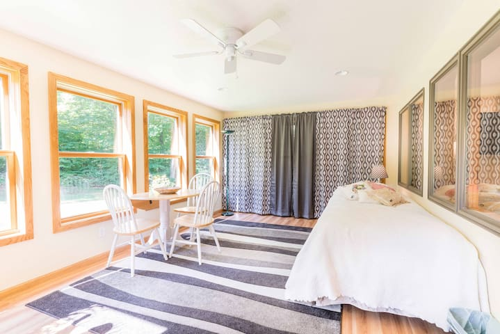 Sunroom with single bed,  game /eating table.   Can be electrically heated but with windows is rarely slept in during winter, unless the outdoor temp is in the 20's and not windy. I'm sure you can imagine from the picture!   Please see L.Rm notes.