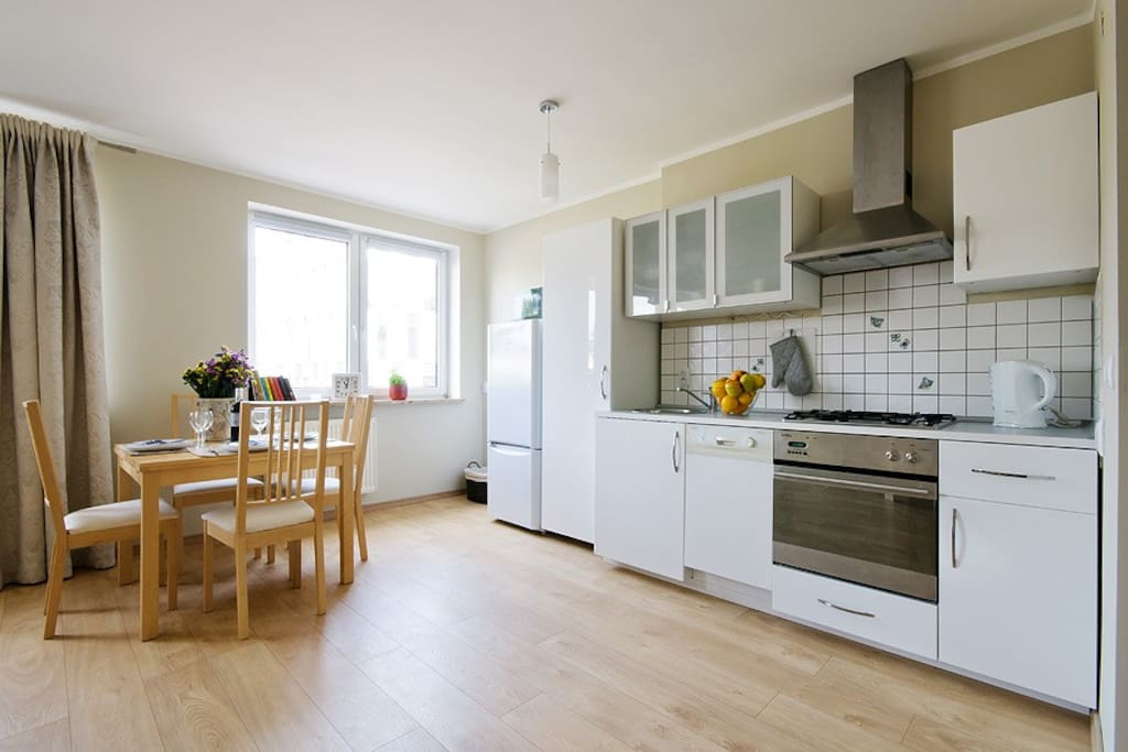 Kitchen with everything on place for a great cooker : owen, microwave, dishwasher, air outside extractor. You will have for your disposal all pots, frying pan, toster, juice squizeer, electric keetle, mixer and all other pratique equpimenet.