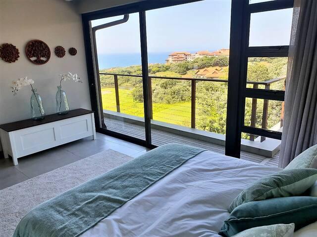Bedroom #3 - queen size bed; sea view; balcony; aircon & roof fan; en suite bathroom