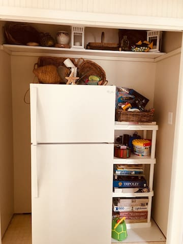 Small refrigerator in hallway of second floor. Very convenient for storing extra beverages and ice.  There is not an ice maker in this frig but there are ice trays available.