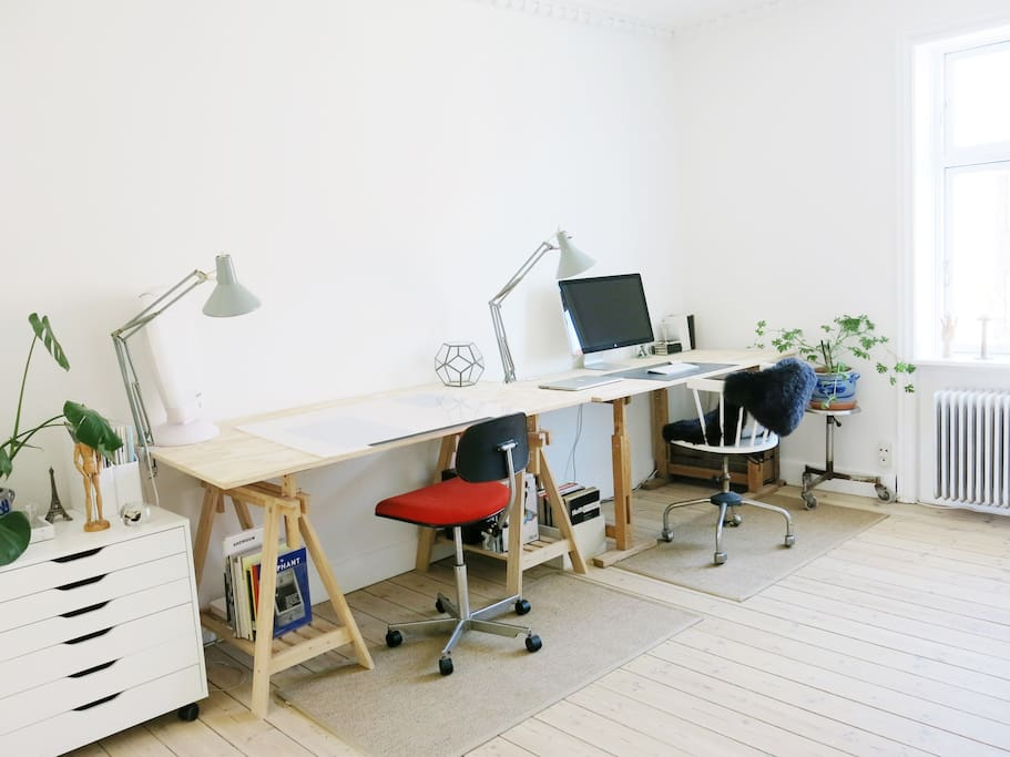 Feel free to use my home studio area! The drawing desk is adjustable and the Apple screen can easily be connected to your personal laptop.