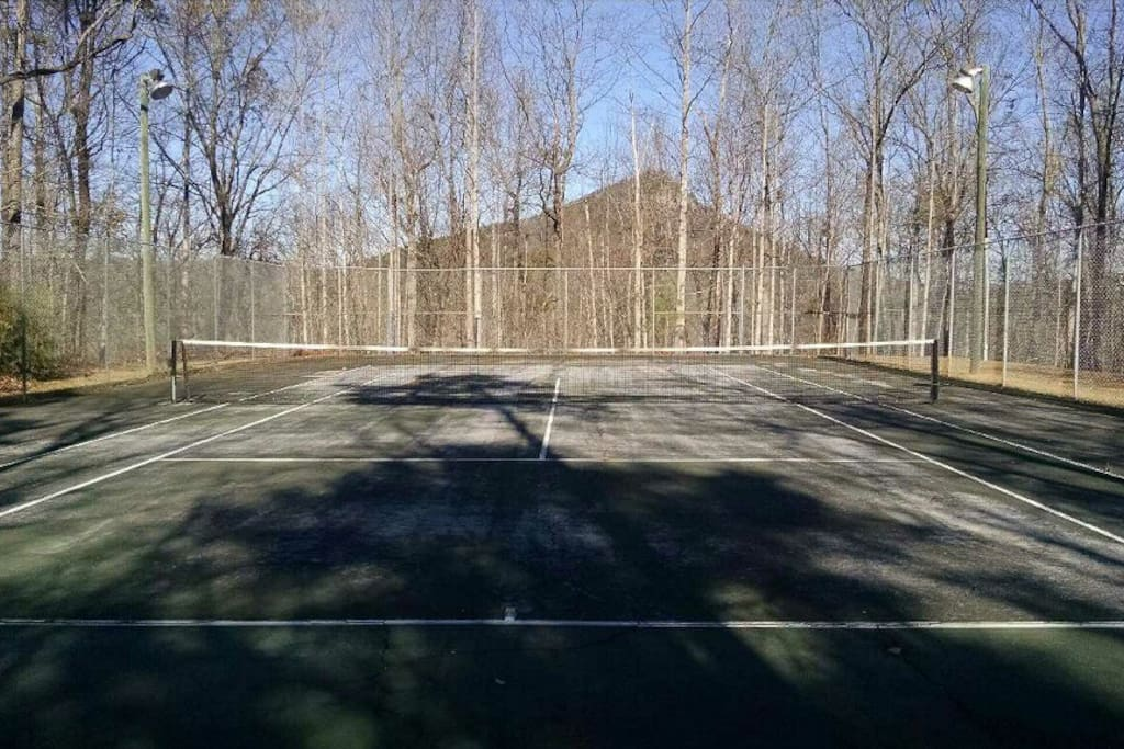 Tennis court on property.