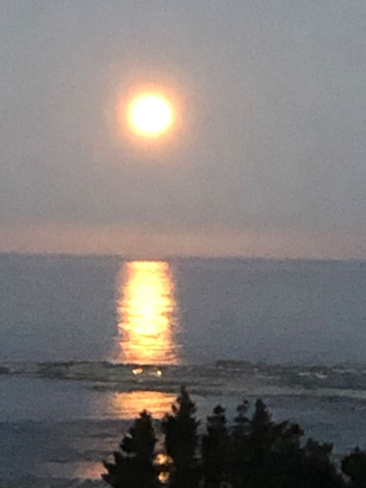 The moon rise and reflections over looking the Seal Colony. Taken from our gate.