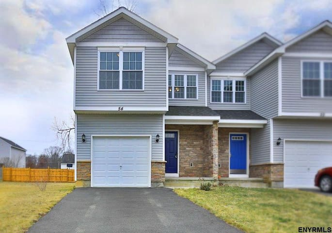 Home away from home! Entire Townhouse. Large Yard.