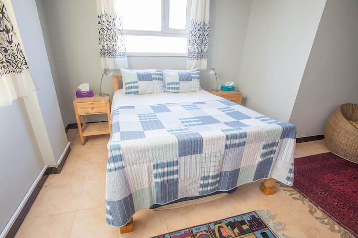 Sunny Bedroom in Welcoming Neighborhood