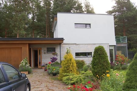 1st floor of a house and a garden - House