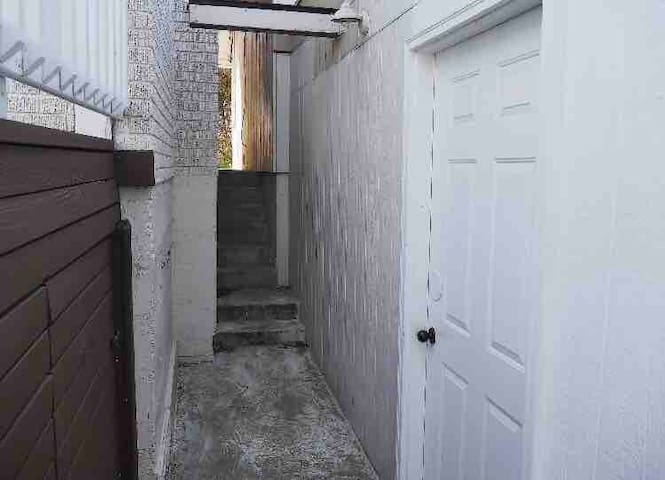 Private entrance to garage dorm bed area