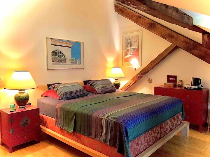 Large attic room with style center
